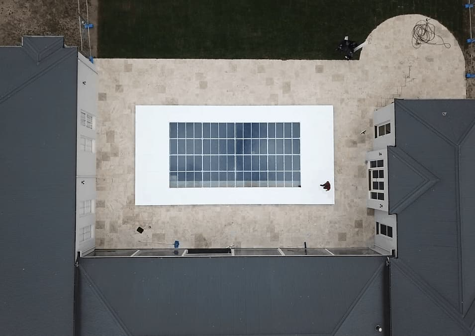 Top view of a clear acrylic pool cover stage