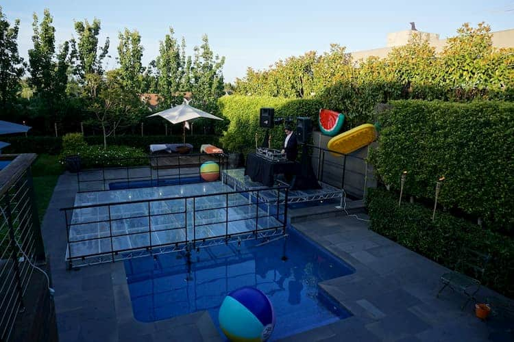 Pool cover stage with DJ setup
